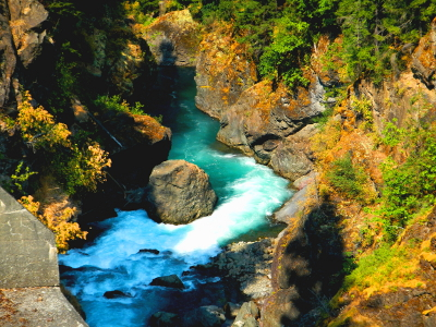 Looking down into the churning blue water of Elwha River though Glines Canyon as viewed from the Elwha River Restoration Kiosk Overlook