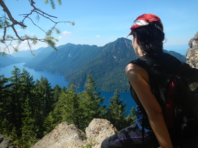 A stunning eagle-eye view of deep blue and vast Lake Crescent from the perspective of a hiker