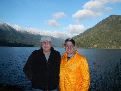 Two participants smile in front of Lake Crescent in Olympic National Park