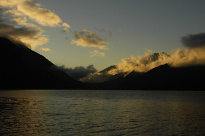 Washington State's Lake Crescent pictured at dusk with colorful clouds