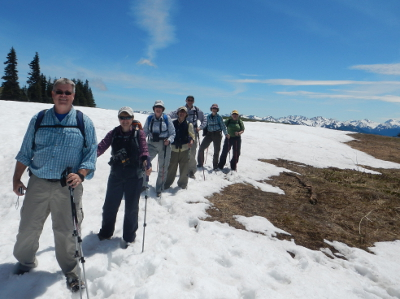Olympic National Park hikers pose on a lingering snowfield at Hurricane Ridge in Olympic National Park