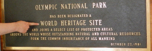 World Heritage Site placard in the Hoh Rainforest that reads that ONP is recognized because of its outstanding natural and cultural resources that form the common inheritance of all mankind