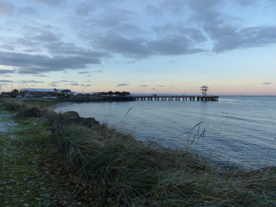 View of the Port Angeles City Pier at dusk taken from the Olympic Discovery Trail