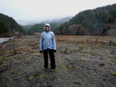 A person in a rain jacket and rain pants on the former delta of Lake Mills Reservoir