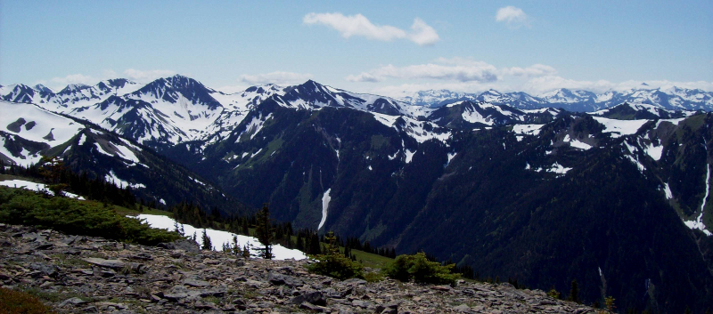 Stunning view from Hurricane Ridge with late season snow as seen while traveling on the Olympic Peninsula.